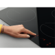 Plita incorporabila vitroceramica Zanussi ZHRN642X, 60 cm, 4 zone de gatit, Touch control, Rama Inox, Culoare Neagra